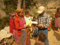 Mother recieving Micronutrient Powder during distribution